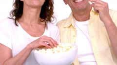 Happy young couple wearing 3d glasses eating popcorn Stock Footage