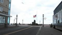 American Flag At Half Staff In Seaside Oregon Stock Footage