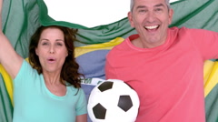 Excited football fan couple holding brazil flag Stock Footage