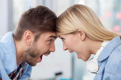 Attractive two designers are celebrating well-done job - stock photo