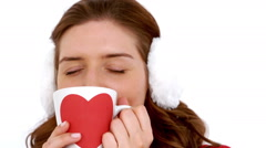 Girl in winter clothes smiling at camera behind her coffee Stock Footage