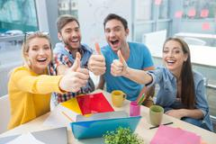 Stock Photo of Attractive young designers are expressing positive emotions