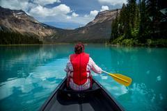 Woman canoeing in Emerald Lake, Yoho National Park, British Columbia Canada - stock photo