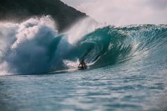 Man bodyboarding in the Caribbean - stock photo