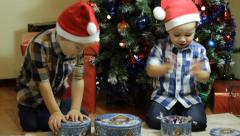 Toddlers with candy boxes on Christmas Stock Footage