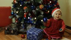 Toddler smilling next to Christmas tree - stock footage