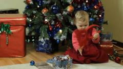Toddler playing next to a Christmas tree - stock footage