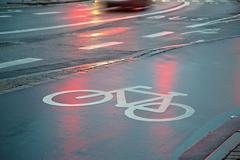 Bicycle lane in the rain Stock Photos