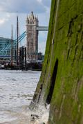 Tower Bridge seen from the shore of the River Thames - stock photo