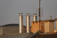 Roofs and chimneys Stock Photos