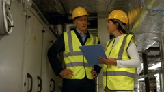 Engineers working in temperature control room Stock Footage