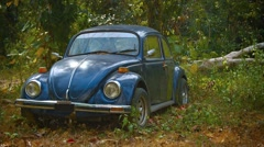 Old Volkswagen Beetle, Abandoned in the Woods Stock Footage