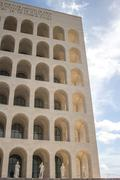 Low angle view of Square Coliseum against blue sky, Lazio, Rome, Italy - stock photo