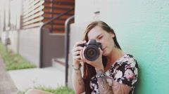 A beautiful girl taking pictures with a camera, slow motion Stock Footage