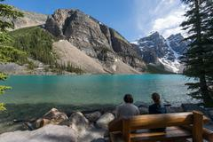 Two people sitting by Moraine Lake, Banff National Park, Canadian Rockies, Stock Photos