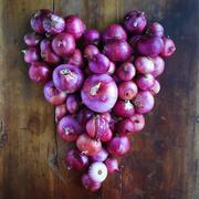 Onions arranged in heart shape - stock photo