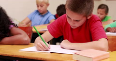 Pupils working at school Stock Footage
