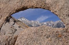 Mount whitney seen through a natural arch, California, America, USA - stock photo