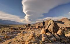 Man standing on a rock, Alabama Hills, Inyo County, California, USA - stock photo