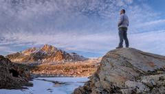 Man looking at mount humphreys, Sierra National Forest, California, USA Stock Photos
