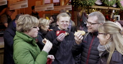 People eating bratwurst sausages Germany Stock Footage