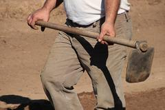 Mid section of a man holding digging hoe Stock Photos