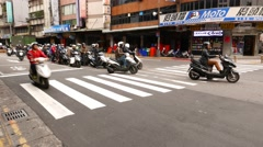 Many motorbikes stand at street intersection, start to move on green light. Stock Footage