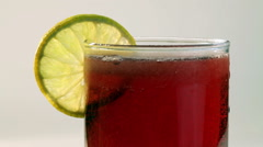 Red Carbonated Drink In Glass With Lemon Stock Footage
