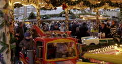 Children at merry go round christmas market Germany Stock Footage