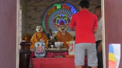 Man offers flowers at Dorngkeur shrine,Phnom Penh,Cambodia Stock Footage