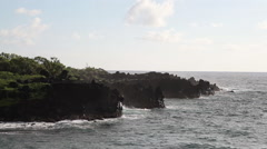 High tide crashing against lava rock cliffs in Maui Stock Footage