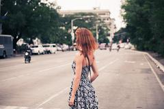 Young woman walking in Manila Kuvituskuvat