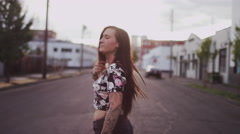 Beautiful girl with long hair in an empty street, slow motion Stock Footage