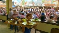 4K UHD POV Oktoberfest Munich Beer Festival waitress carrying tray of meat Stock Footage