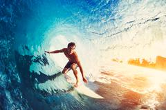 Surfer on Blue Ocean Wave Kuvituskuvat