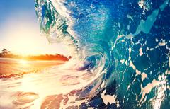 Oceaen Wave at Sunrise Stock Photos