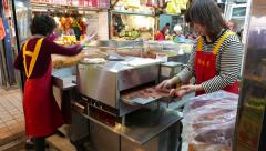 Bacon drying machine, work on the open-street dry goods store counter Stock Footage