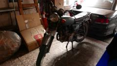 Old Sanyang (SYM) motorbike in dark garage Stock Footage