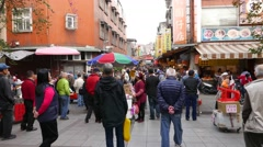 Crowd at casual street market, many people, POV walk forward Stock Footage