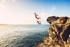 Summer Fun, Cliff Jumping - stock photo