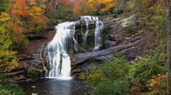 Waterfall cascading, autumn leaves MWS Stock Footage