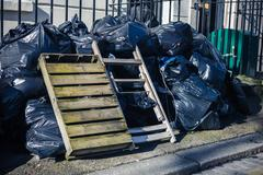 Bags of rubbish in the street - stock photo