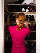 Woman organizing her shoes Stock Photos