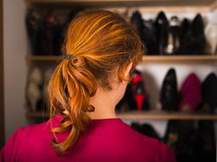 Woman organizing her shoes - stock photo