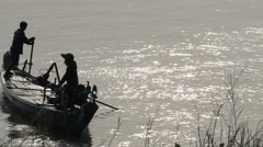 Fishermen in small boat on Tonle Sap River,Phnom Penh,Cambodia Stock Footage