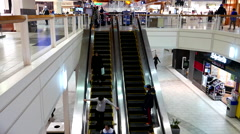 One side of people on moving escalator inside mall - stock footage
