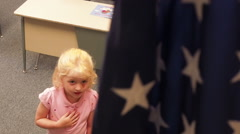 Little Girl Saying Pledge To Flag Stock Footage