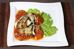 baked eggplant with cheese and vegetable sauce - stock photo