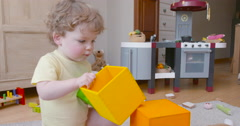 Baby boy building tower of square blocks slow motion 60fps 1 Stock Footage