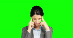 Worried businesswoman holding her head Stock Footage